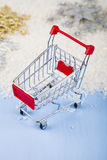 Shopping carts and Christmas decorations in the snow. Concept of Stock Photo