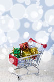 Shopping carts with Christmas gifts in the snow. Concept of Chri Royalty Free Stock Photos