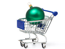 Shopping carts and Christmas green balls Stock Images