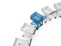 Shopping carts in curved row. Shopping carts or trollies in a curved row. One blue one stands out from the white ones Royalty Free Stock Photo