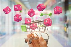 From shopping carts flying cubes with interest. The concept of discounts Stock Photos