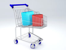 Shopping carts full of shopping bags Royalty Free Stock Photos