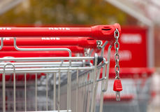 Shopping carts of the german supermarket chain, Rewe stands together in a row on parking area Royalty Free Stock Image