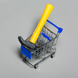 Shopping carts with a hammer. Stock Photography