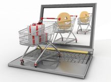 Shopping carts and laptop Royalty Free Stock Image