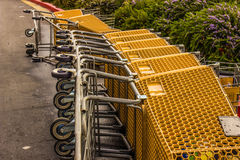 Shopping Carts Laying On Side In Parking Lot Royalty Free Stock Photos