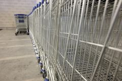 Shopping carts lined up. Day Royalty Free Stock Images