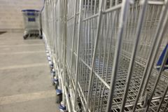 Shopping carts lined up. Day Stock Images