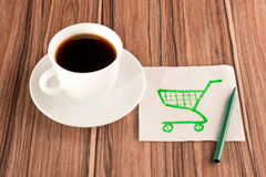 Shopping carts on a napkin Stock Images