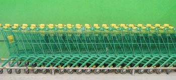 Shopping carts on a parking lot banner background Royalty Free Stock Photos