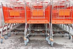 Shopping carts on a parking lot Stock Photos