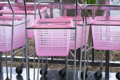 Shopping carts pink color in a Retail department store. Small shopping carts pink color in a Retail department store royalty free stock images