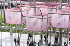 Shopping carts pink color in a Retail department store. Small shopping carts pink color in a Retail department store royalty free stock image