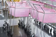 Shopping carts pink color in a Retail department store. Small shopping carts pink color in a Retail department store royalty free stock photo