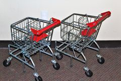 Shopping carts. Reusable sustainable steel and red shopping carts Stock Image