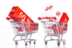 Shopping carts with sales icons Royalty Free Stock Images