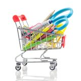 Shopping carts with school supplies isolated on a white, back to stock photo