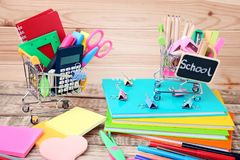 Shopping carts with school supplies royalty free stock image