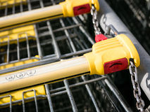Shopping carts. Shopping carts stay on parking, locking system on the coin Stock Photos