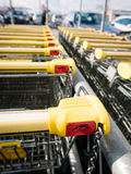 Shopping carts. Shopping carts stay on parking, locking system on the coin Royalty Free Stock Photography