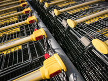 Shopping carts. Shopping carts stay on parking, locking system on the coin Stock Image