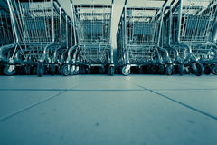 Shopping carts in supermarket. In rows ready for consumers Stock Image