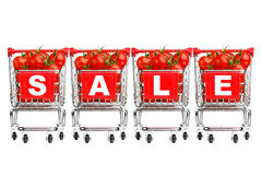 Shopping carts with tomatoes Royalty Free Stock Photo