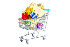 Shopping carts, trolley with boxes of colorful gifts isolated on white Royalty Free Stock Image