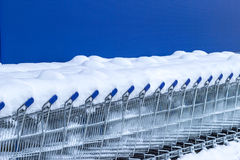 Shopping carts under the snow. Shopping carts covered by snow Stock Photo