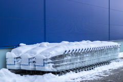 Shopping carts under the snow Royalty Free Stock Image