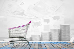 shopping carts on the wooden floor with banknote and coins backg Royalty Free Stock Image