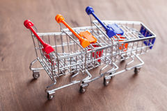 Shopping carts on wooden surface. Stock Photo