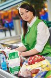 Shopping. Cashdesk worker in supermarket Stock Photo