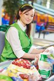 Shopping. Cashdesk worker in supermarket Royalty Free Stock Photos