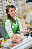 Shopping. Cashdesk worker in supermarket Stock Images