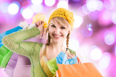 Shopping caucasian girl. A beautiful caucasian girl carrying shopping bags Royalty Free Stock Photography