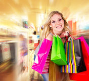 In shopping center. Happy blond woman with shopping bags in shopping center Stock Photo