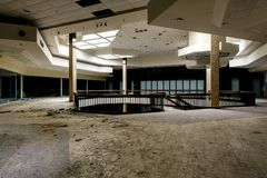 Shopping Center - Abandoned Randall Park Mall - Cleveland, Ohio. A view of the a dead tree in the center concourse inside the abandoned Randall Park Mall near Royalty Free Stock Photos