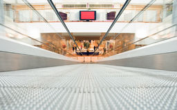 Shopping center (blurred). Shopping center, moving staircase(blurred royalty free stock image