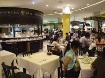 Shopping center cafe, Bangkok, Thailand. BANGKOK, THAILAND - JANUARY 8: Restaurant opens at the Siam Paragon shopping center at the grand opening. January 8 Royalty Free Stock Photography