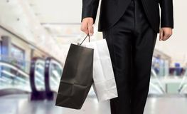 Shopping in a shopping center. Close up of business man shopping in a shopping center Stock Image