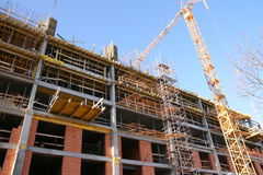 Shopping center construction with crane Royalty Free Stock Image