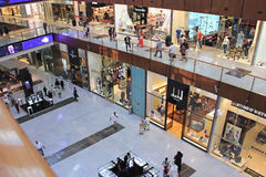 Shopping center Dubai Mall, top view inside, , United Arab Emira. Shopping center Dubai Mall, top view inside, boutiques and people make purchases, United Arab Royalty Free Stock Photos