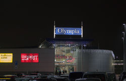 Shopping center Olympia decorated with lights  at night. Stock Photo