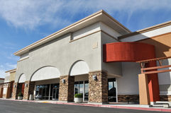 Shopping Center Strip Mall. With Parking Lot Stock Images