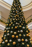 Shopping center- tall Christmas tree decorated baubles Stock Photo