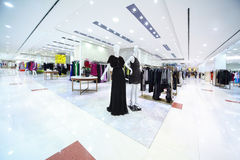 Shopping center with womanish clothes Royalty Free Stock Photo