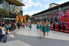 Shopping Centre. Shoppers visit Siam Paragon mall courtyard as a Christmas choir performs on March 27, 2012 in Bangkok, Thailand. Siam Paragon boasts 300,000 Stock Photography