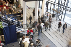 Shopping centre. People in entrance of shopping centre royalty free stock photography