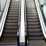 Shopping Centre Escalators. Twin up and down escalators in a shopping centre, mall stock photos